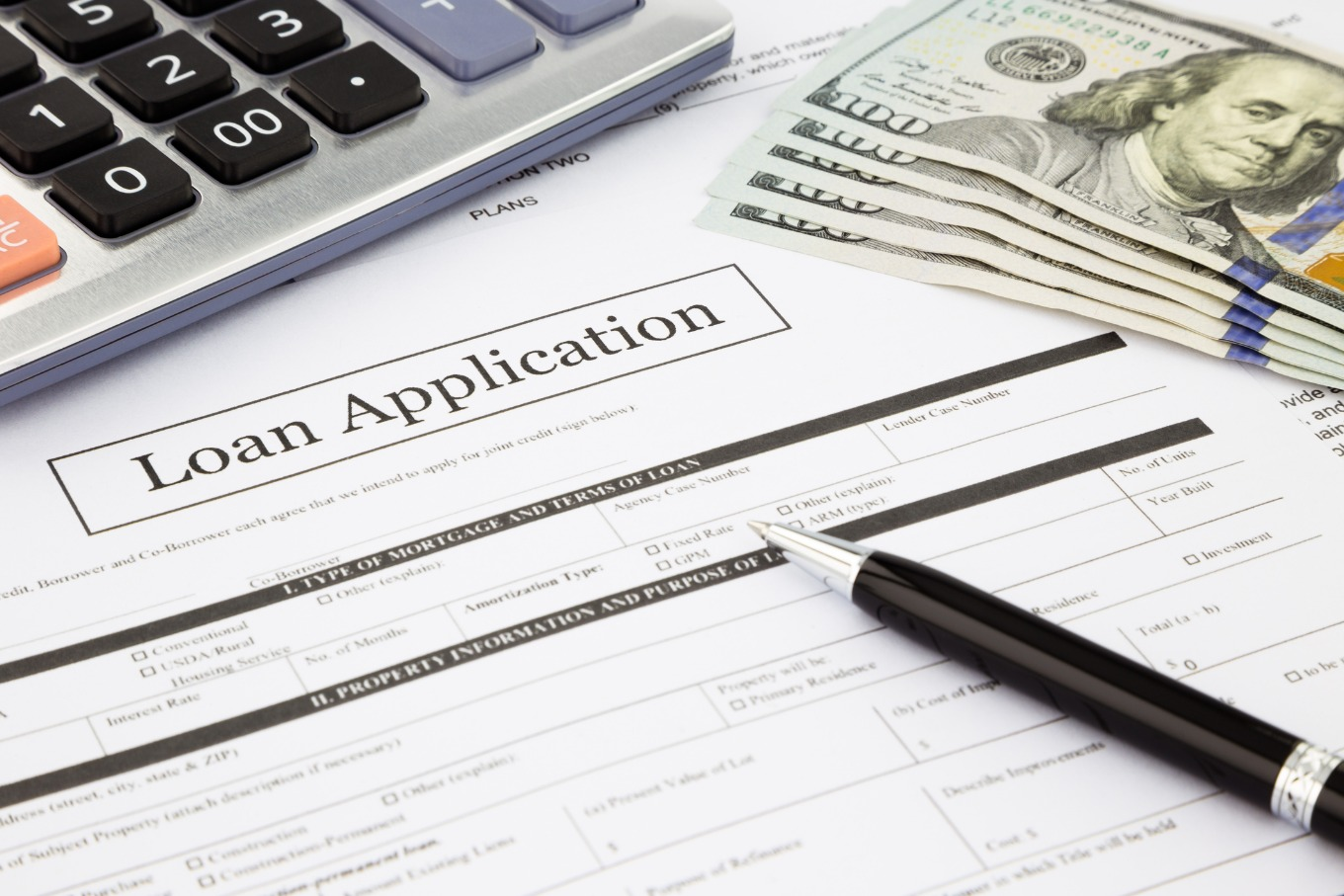 Home loan application with pen and calculator